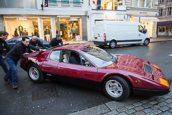 London, UK. 29th November, 2018. Auctioneers Bonhams move a 1975 Ferrari 365 GT4 Berlinetta Boxer in preparation for an auction of historic and high-performance racing and road cars. Highlights include a Le Mans class-winning Jaguar XJ220C driven by David Coulthard (£2,200,000-2,800,000), a Lister Jaguar Knobbly (£2,200,000-2,800,000) and a 1958 BMW 507 owned by its designer, as well as Ferraris, Aston Martins, Bentleys, Porsches and Jaguars. Bonhams, founded in 1793, is one of the world's largest and most renowned auctioneers of fine art and antiques, motor cars and jewellery.