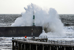 © Licensed to London News Pictures. 19/09/2018. Aberystwyth, UK. Waves batter the harbour wall and lighthouse in Aberystwyth as Storm Ali, the first named storm of the UK winter season, rips through the Irish Sea, bringing 70mph winds and heavy rain to northern and western parts of the UK. Photo credit: Keith Morris/LNP