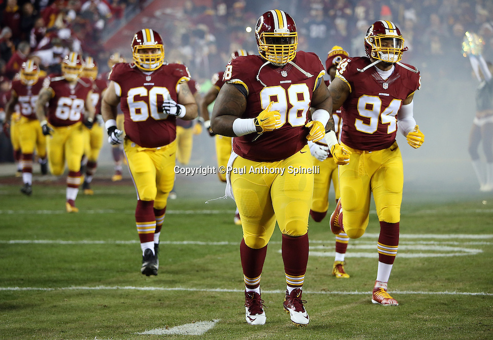 Washington Redskins defensive tackle Terrance Knighton (98) runs onto the field during pregame player introductions before the 2015 week 13 regular season NFL football game against the Dallas Cowboys on Monday, Dec. 7, 2015 in Landover, Md. The Cowboys won the game 19-16. (©Paul Anthony Spinelli)