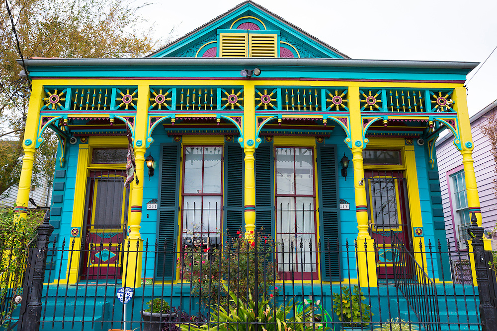 Traditional bright clapboard creole cottage home with front stoop in Faubourg Marigny historic district  of New Orleans, USA