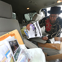 """Jennifer Jones known as a """"Community Angel"""" gathers her items from her van at the Cook's Adult Day Care in New Albany where she comes visit."""