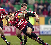 © Peter Spurrier/ Intersport Images.Photo Peter Spurrier.01/03/2003 Sport - Semi final Powergen Cup Rugby -.Leicester  v Gloucester - Franklin Gardens.Thinus Delport is tackled by Rod Kafer..