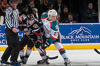 KELOWNA, CANADA - JANUARY 18: Calvin Thurkauf #27 of the Kelowna Rockets checks Brett Howden #21 of the Moose Jaw Warriors after the face off on January 18, 2017 at Prospera Place in Kelowna, British Columbia, Canada.  (Photo by Marissa Baecker/Shoot the Breeze)  *** Local Caption ***