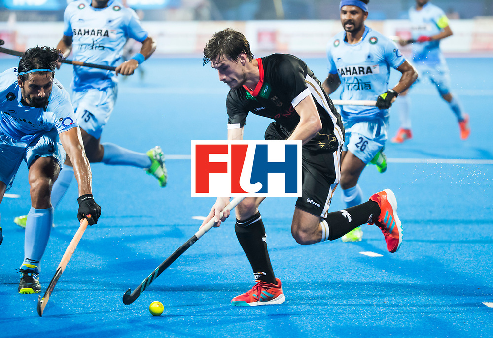 BHUBANESWAR - Hockey World League finals Match for bronze , Germany v India (1-2). Florian Fuchs (Ger) with Rupinder Pal Singh (Ind) COPYRIGHT KOEN SUYK