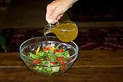 Adding virgin olive oil to a salad