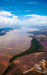 An aerial view of mud flowing down a river in the wet season, east Kimberley.