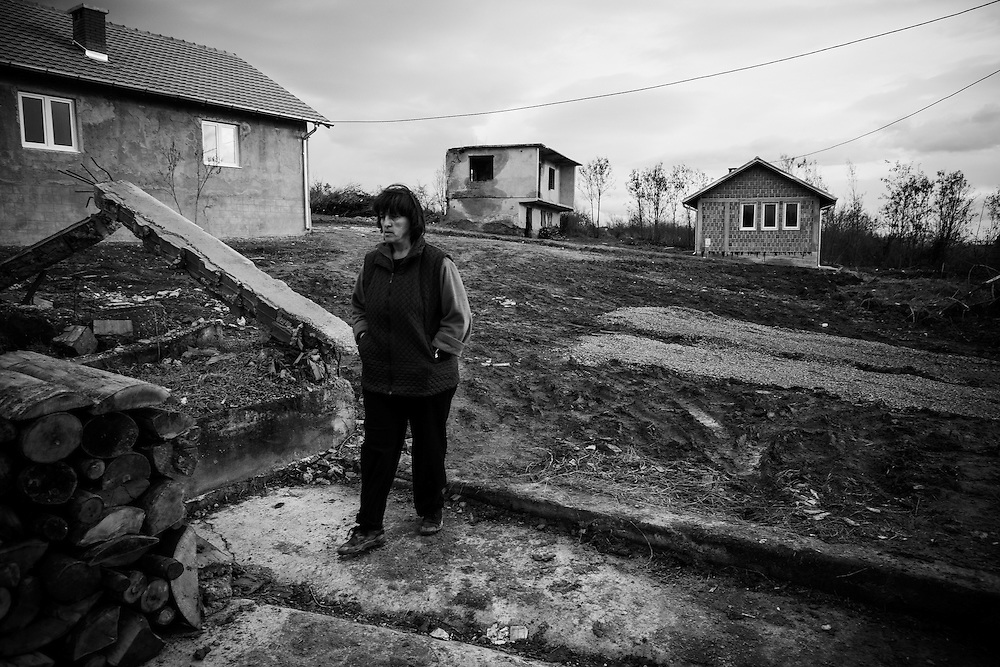 A Serb returnee walks through newly constructed housing specifically built for returnees.