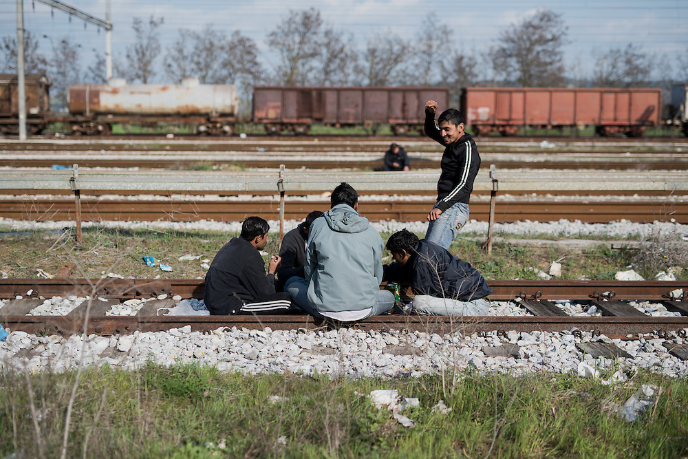 A group of Indians drinking beers and dancing at the railway tracks n Idomeni train station. <br /> <br /> Thousands of refugees are stranded in Idomeni unable to cross the border. The facilities are stretched to the limit and the conditions are appalling.