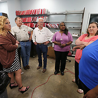 Lee County Circuit Clerk Camille Roberts Dulaney, left, get ready to start inspecting the new voting machines recently purchased.