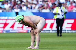 A streaker pauses to catch breath before getting away from the stewards, stopping play between England and New Zealand - Mandatory by-line: Robbie Stephenson/JMP - 03/07/2019 - CRICKET - Emirates Riverside - Chester-le-Street, England - England v New Zealand - ICC Cricket World Cup 2019 - Group Stage