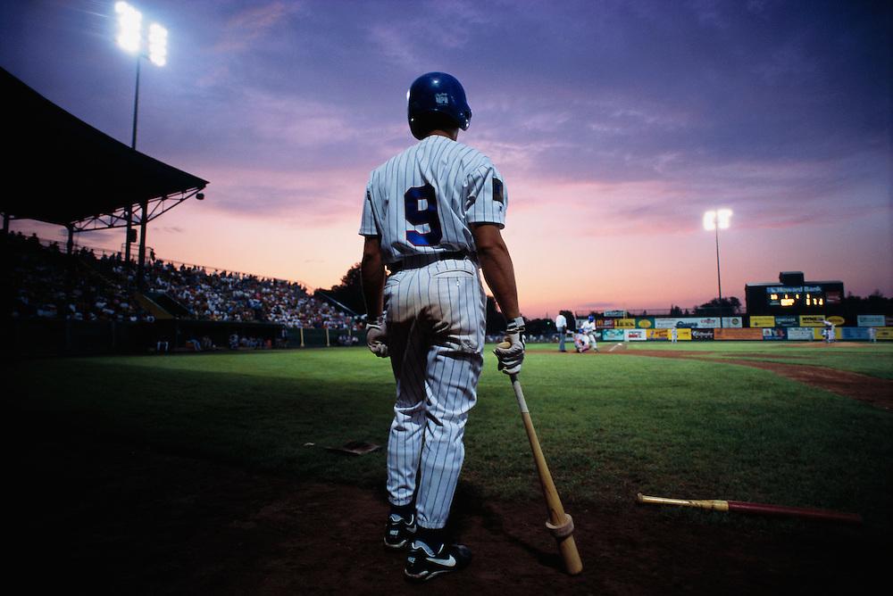 July 1995, Burlington, Vermont, USA --- Baseball Player Watching Game --- Image by © Christopher J. Morris/CORBIS