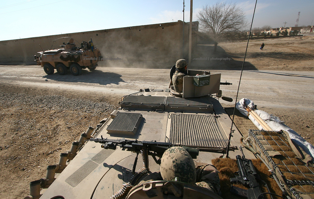 An armored convoy of the german Quick Reaction Force (QRF)  meets a swedish tank (backgr.) during a patrol in the surroundings and centre of northern afghani town Mazar-e Sharif.