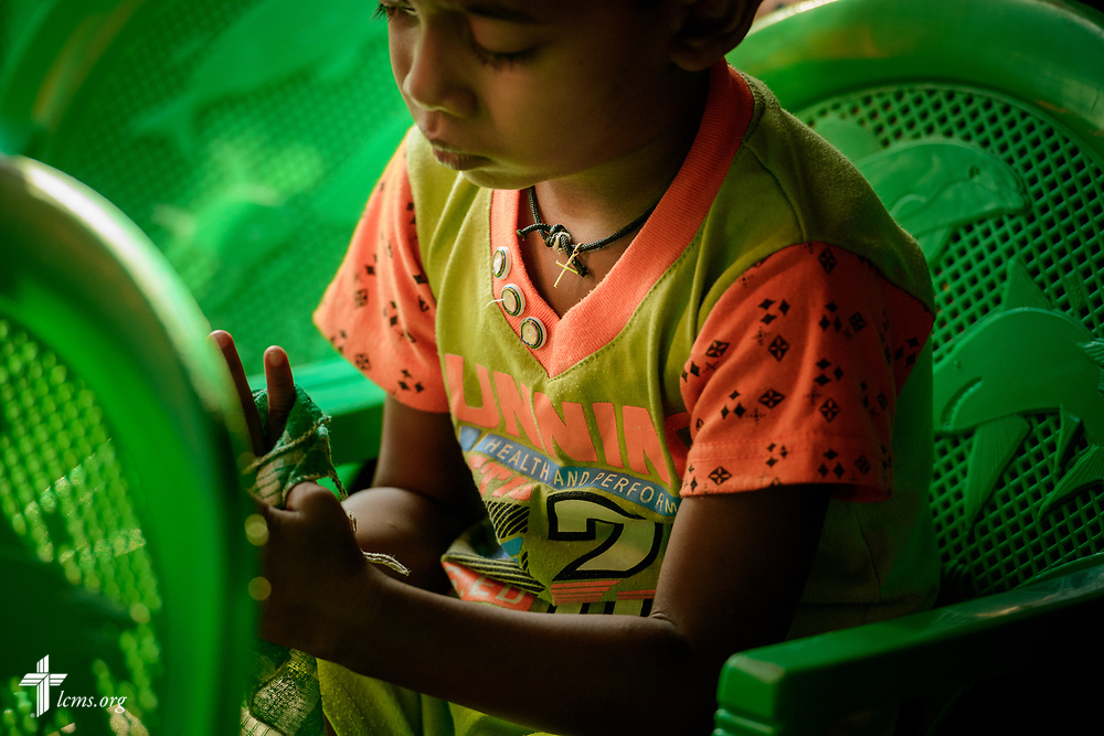 A young worshipper at service on the Eila rubber plantation in the Sabaragamuwa Province of Sri Lanka on Sunday, Jan. 21, 2018.  LCMS Communications/Erik M. Lunsford