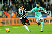 DeAndre Yedlin (#22) of Newcastle United dribbles the ball forward under pressure from Jordon Ibe (#10) of Bournemouth during the Premier League match between Newcastle United and Bournemouth at St. James's Park, Newcastle, England on 10 November 2018.
