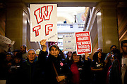 Protestors wait outside Wisconsin Governor Scott Walker's in the State Capitol in Madison, Wisconsin, February 23, 2011.