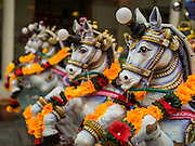 05 OCTOBER 2014 - GEORGE TOWN, PENANG, MALAYSIA:  Horses on the chariot that will carry the deity before a procession honoring Durga in George Town during the Navratri procession. Navratri is a festival dedicated to the worship of the Hindu deity Durga, the most popular incarnation of Devi and one of the main forms of the Goddess Shakti in the Hindu pantheon. The word Navaratri means 'nine nights' in Sanskrit, nava meaning nine and ratri meaning nights. During these nine nights and ten days, nine forms of Shakti/Devi are worshiped.   PHOTO BY JACK KURTZ