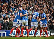 Portsmouth players celebrate after Portsmouth forward Michael Smith makes it 1-0 during the Sky Bet League 2 match between Portsmouth and Carlisle United at Fratton Park, Portsmouth, England on 2 April 2016. Photo by Adam Rivers.