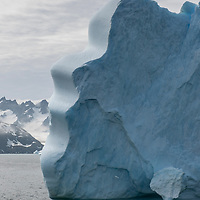 An iceberg with a unique curved shape in Dygalski Fjord on South Georgia Island.