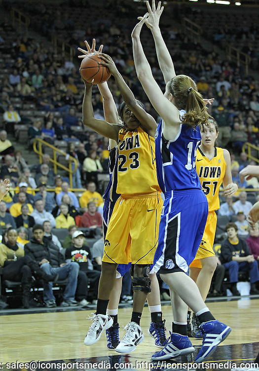 December 20, 2011: Iowa Hawkeyes guard Theairra Taylor (23) tries to put up a shot as Drake Bulldogs forward Rachael Hackbarth (15) defends during the NCAA women's basketball game between the Drake Bulldogs and the Iowa Hawkeyes at Carver-Hawkeye Arena in Iowa City, Iowa on Tuesday, December 20, 2011. Iowa defeated Drake 71-46.