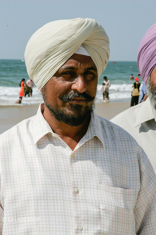 Portrait of a sikh man with turban  at the beach