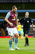 Ron Vlaar of Aston Villa limps from an injury during the Barclays Premier League match at Villa Park, Birmingham<br /> Picture by Andy Kearns/Focus Images Ltd 0781 864 4264<br /> 01/01/2015