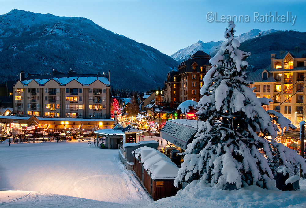 Whistler Village glows with lights at sunset on a winter evening