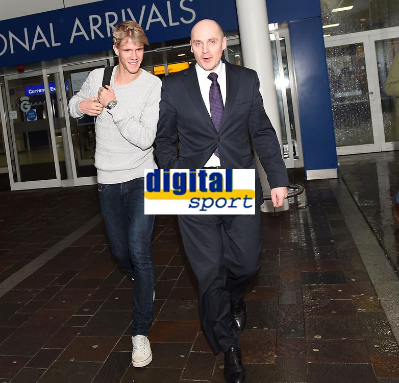 16/02/16<br /> GLASGOW INTERNATIONAL AIRPORT<br /> Kristoffer Ajer arrives at Glasgow International Airport, escorted by Celtic physiotherapist Tim Williamson.