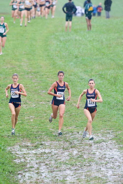 Katie Read (234/University of Virginia),  Stephanie Garcia (231/University of Virginia), and  Lauretta Dezubay (229/University of Virginia) lead the field after the first mile.  The Lou Onesty Invitational Cross Country meet was hosted by the University of Virginia XC team and held at Panorama Farms near Charlottesville, VA on September 6, 2008.  Athletes endured rain and wind from Tropical Storm Hanna during the race.