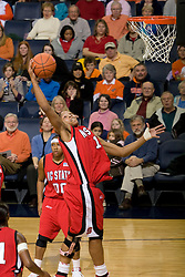 N.C. State forward Khadijah Whittington (1) grabs a rebound against Virginia.  The Virginia Cavaliers defeated the NC State Wolfpack women's basketball team 74-49 at the John Paul Jones Arena in Charlottesville, VA on February 1, 2008.