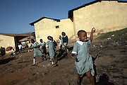 "Children play in the Korogocho slum in Nairobi, Kenya, on Monday, Jan. 12, 2009. Korogocho is third largest slum in Nairobi and has a population of approximately 250,000 with an average of 5-6 persons per room. The ITC (International Trade Center) and MAX&Co. work with communities from these areas to promote ""ethical fashion"" which they hope will  ""make a tangible contribution to those who live in marginal conditions and hardship."""