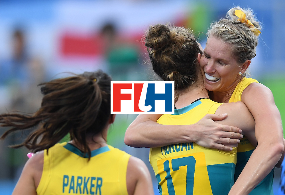 Australia's Jodie Kenny (R) celebrates scoring a goal during the women's field hockey India vs Australia match of the Rio 2016 Olympics Games at the Olympic Hockey Centre in Rio de Janeiro on August, 10 2016. / AFP / MANAN VATSYAYANA        (Photo credit should read MANAN VATSYAYANA/AFP/Getty Images)