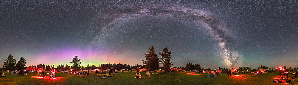 A 360&deg; panorama of the Saskatchewan Summer Star Party, August 4, 2016, at the Meadows Campground in Cypress Hills Inter-Provincial Park, south of Maple Creek, Saskatchewan. The Park is a Dark Sky Preserve and is home to the annual star party that attracts about 300 people and telescopes each summer. <br /> <br /> A aurora is at left to the north while the Milky Way arches overhead from northeast to southwest, with the galactic centre in Sagittarius at right. Saturn and Mars are setting to the right of the Milky Way in Scorpius. The Big Dipper is at far left. Some faint bands of airglow are in the south at right. The Andromeda Galaxy is just left of centre. <br /> <br /> This is a 21-panel (3 tiers of 7 segments each) panorama shot with the iOptron iPano and stitched with PTGui. Each segment was 30 seconds at f/2.8 and ISO 6400.
