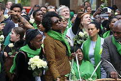 © Licensed to London News Pictures. 14/06/2019. London, UK. People wearing a symbolic green scarves take part in a ceremony to commemorate the second anniversary of the Grenfell Tower fire. On 14 June 2017, just before 1:00am a fire broke out in the kitchen of the fourth floor flat at the 24-storey residential tower block in North Kensington, West London, which took the lives of 72 people. More than 70 others were injured and 223 people escaped. Photo credit: Dinendra Haria/LNP
