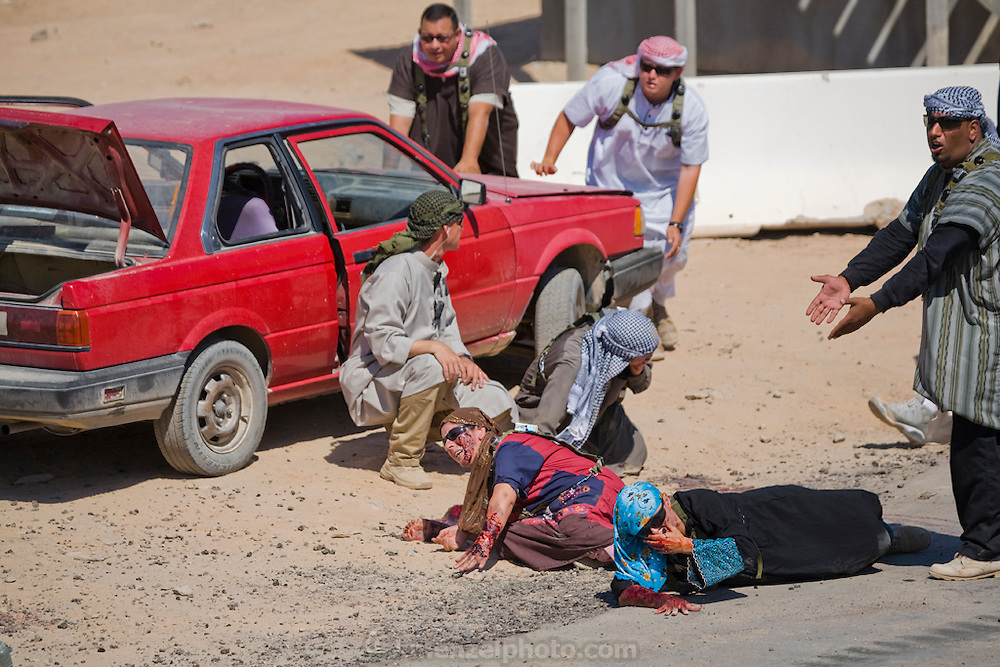 Actors stage a crisis situation in Medina Wasl, a fabricated Iraqi village  at Camp Irwin, in California's Mojave Desert.