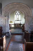 Elaborately decorated stone 12th century Norman chancel arch inside the historic village parish church  Marden, Wiltshire, England, UK