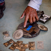 Peter Lee Yazzie lays out his silversmithing tools at his home in Steamboat Tuesday.