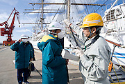 Staff involved with delivering goods to the nuclear power plants are given a radiation check prior to boarding the Kaiwomaru, which is hosting some of the members of the so called Fukushima 50, in the dock at Onahama Port, Iwaki City, Fukushima Prefecture on  23 March 20011.  .Photographer: Robert Gilhooly