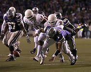 Kansas State quarterback Josh Freeman (1)loses the ball after getting hit by Roy Miller (99) of Texas at Bill Snyder Family Stadium in Manhattan, Kansas, November 11, 2006.  The Wildcats upset the 4th ranked Longhorns 45-42.<br />