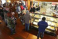 Customers surround the counter at the Amana Colonies Bakery & Cafe during Winterfest at the Amana Colonies in Amana on Saturday, January 26, 2013.