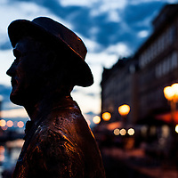 The silhouette of James Joyce's statue on the literary trail on the Gran Canale in Trieste, Italy