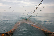 Fishing nets for trawler fishing are lowered into the sea using steel cords in Hythe Bay, the English Channel, United Kingdom. Dungeness Power Station can be seen on the horizon. (photo by Andrew Aitchison / In pictures via Getty Images)