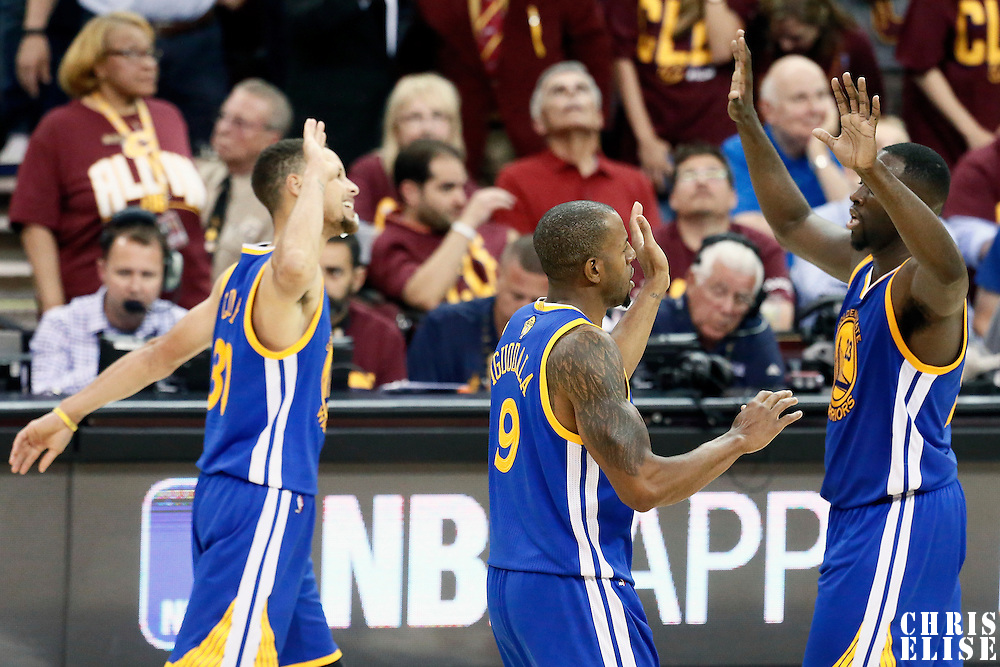 10 June 2016: Golden State Warriors forward Andre Iguodala (9) and Golden State Warriors guard Stephen Curry (30) are congratulated by Golden State Warriors forward Draymond Green (23) during the Golden State Warriors 108-97 victory over the Cleveland Cavaliers, during Game Four of the 2016 NBA Finals at the Quicken Loans Arena, Cleveland, Ohio, USA.