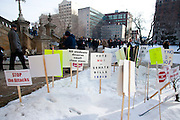 """Protestors signs are left outside during a protest against Emergency Financial Manager legislation at the Michigan State Capital in Lansing, MI, Tuesday, March 8, 2011. Signs are not allowed in the Capital. According to the law, which has already been approved in the House, the governor will be able to declare """"financial emergency"""" in towns or school districts and appoint someone to fire local elected officials, break contracts, seize and sell assets, and eliminate services. Under the law whole cities or school districts could be eliminated without any public participation or oversight. (Jeffrey Sauger)"""