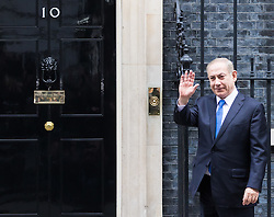 Downing Street, London, February 6th 2017. Israeli Prime Minister Benjamin Netanyahu arrives at 10 Downing Street for lunchtime talks with British Prime Minister Theresa May, with some confusion arising when Mrs May was not immediately on hand to welcome him. Minutes later the two PMs emerged for the traditional handshake photographs at the door of No 10.  PICTURED: Netanyahu makes his way to the door of Number 10, expecting Theresa May to emerge for the traditional handshake photograph.