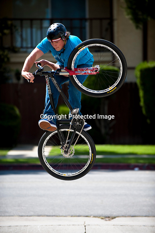 Kyle Strait performs a tabletop bunnyhop on the streets of Huntington Beach, California