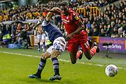Millwall midfielder Jayson Molumby (16) battles for possession with Nottingham Forest forward Sammy Ameobi (19) during the EFL Sky Bet Championship match between Millwall and Nottingham Forest at The Den, London, England on 6 December 2019.
