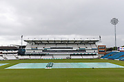 The covers are on at Emerald Headingley following a rain storm ahead of the opening day of the Specsavers County Champ Div 1 match between Yorkshire County Cricket Club and Hampshire County Cricket Club at Headingley Stadium, Headingley, United Kingdom on 27 May 2019.