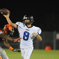 Wilson Hunt's Jacob Williamson throws under pressure Friday September 5, 2014 in Wilmington, N.C. (Jason A. Frizzelle)