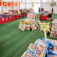 070213       Cable Hoover<br /> <br /> Customers shop as employees stock the shelves at the Cash Cow fireworks tent in Gallup Tuesday.