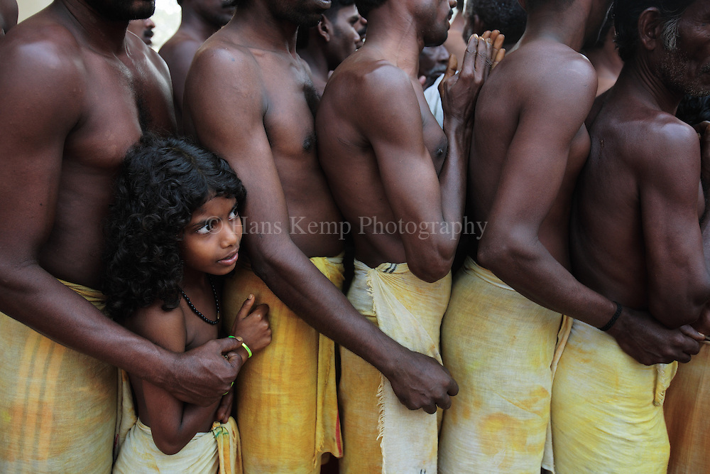A young girl waiting in line to enter a temple in Kodungalor, Kerala, Southern India.